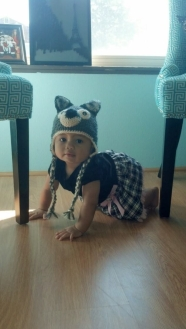 Audrey modeling her wolf hat! Her big sister was Red Riding Hood ;-)